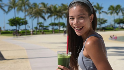 Green smoothie vegetable juice - woman drinking