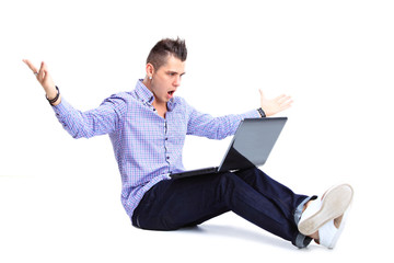 Portrait of happy man working on laptop in casuals