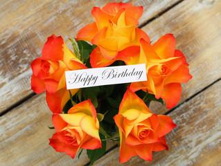 Happy birthday card with orange roses