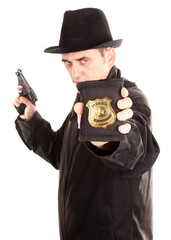Agent with gun is showing special officer badge