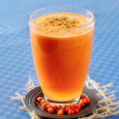 Sea buckthorn, apple and carrot smoothie with pollen
