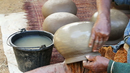 Old woman making a clay pottery,Thai traditional style.