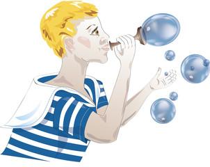 Мальчик пускает мыльные пузыри