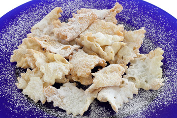 Chiacchiere (or Bugie) -Italian carnival cookies on blue dish