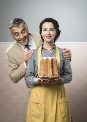 Smiling vintage couple with cake
