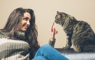 Woman playing with a cat