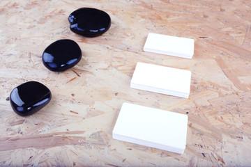 Business cards on dark desk