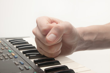 hand striking piano, concept of frustration