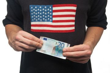 man with american flag on his shirt holding euro money