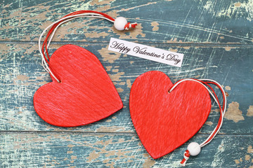 Happy Valentine's day card with two red wooden hearts