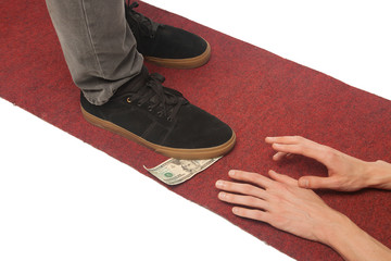 man shoe standing on dollar money with hands stretching