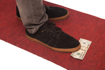 man shoe standing on dollar money isolated on white