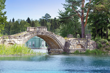 small shabby bridge in park over a pond.Gatchina.Petersburg