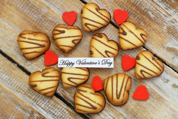 Happy Valentine's day with heart shaped cookies with chocolate