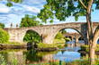 The old stone bridge of Stirling. Summertime outdoors. - 76827123