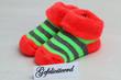 Gefeliciteerd,(congratulations in Dutch), with baby socks