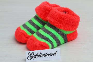 Gefeliciteerd,(congratulations in Dutch), with baby socks