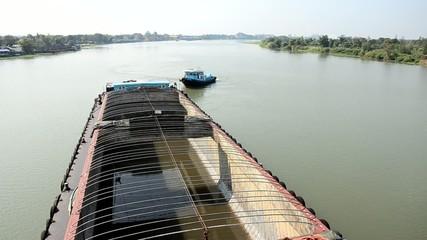 Barge and Tug Boat cargo ship in Choaphraya river at Ayutthaya