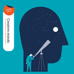 Businessman looking trough a telescope in the head