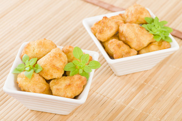 Chicken Nuggets - Battered and deep fried chicken pieces.