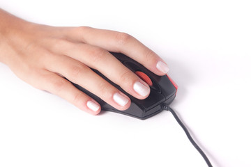 Female hand with computer mouse isolated on white background