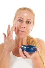Woman of mature age with cream