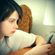 Sad Girl with Cellphone