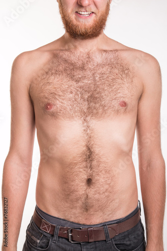 Torso of a man covered with hair - 76832127