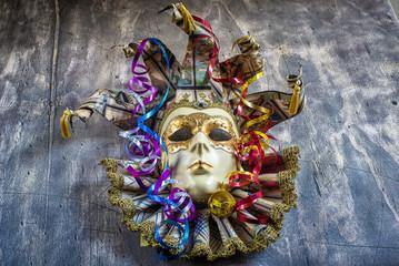 Classical venetian carnival mask and serpentine