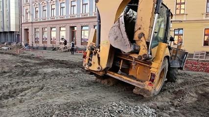 Excavator transports gravel