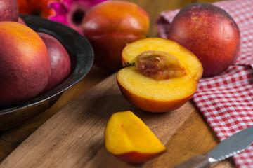 fresh nectarine peach cut on rustic board