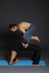 2 man doing acro yoga