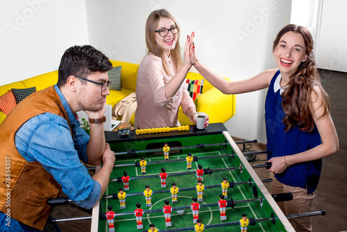 canvas print picture Friends playing table football