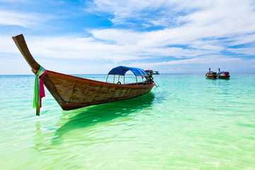 Traditional thai boat on the beach, Thailand.