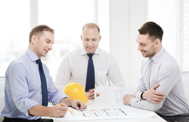 happy team of architects and designers in office
