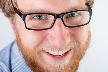 Portrait of a smiling man with glasses and beard