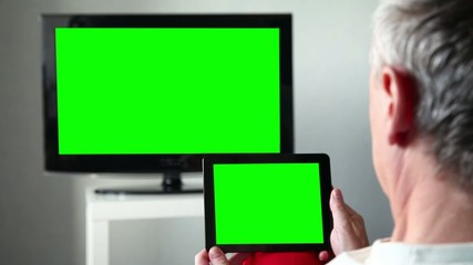 Man With Green Screen Ipad Watches Tv