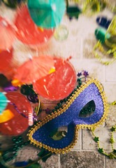 Mardi Gras: Focus On Party Mask With Drinks And Beads Around