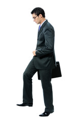 Walking businessman with briefcase, on white