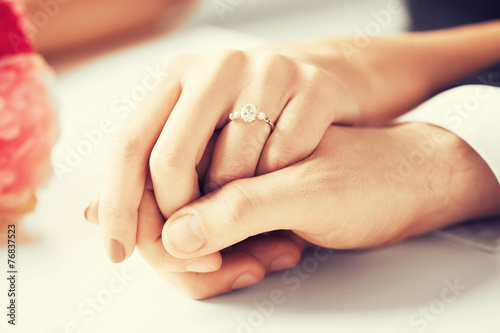 man and woman with wedding ring - 76837523