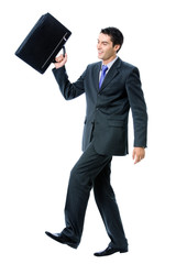 Businessman walking with briefcase, on white