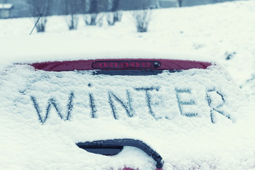 """The inscription """"Winter"""" on a car windshield. Toned image."""