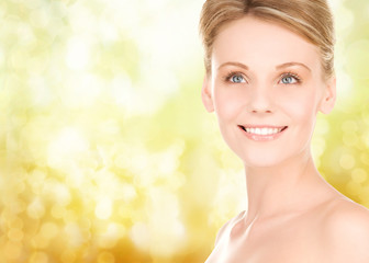 close up of smiling woman over yellow background