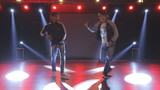 Hip-hop dancers  dances on stage in the club