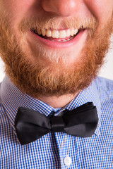 Smiling bearded man with a bow tie