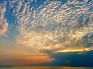 Cloudscape at sunset above sea