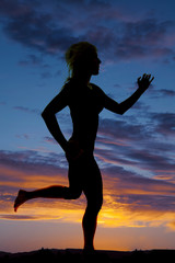 silhouette of a woman running in the sunset