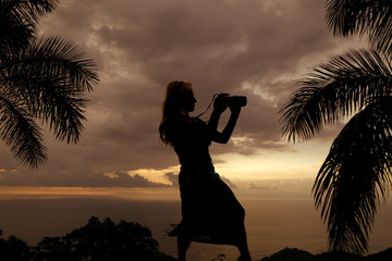 silhouette of a woman with a camera look to side