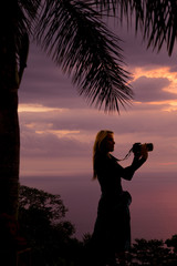 silhouette of a woman with a camera stand