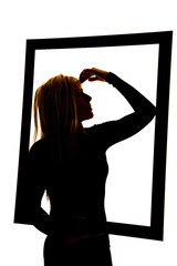 silhouette of woman in frame hand on head